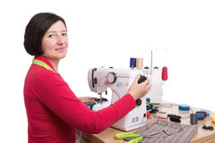 Woman seamstress at the sewing machine. Stock Photography