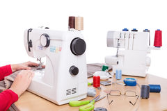 Woman seamstress work on the sewing products. Royalty Free Stock Photo