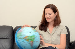Woman Search and Examining the Globe Stock Photography