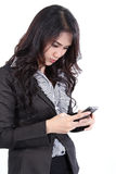 Woman search phone. Business woman standing and search a number on her hand royalty free stock image