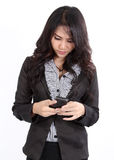 Woman search phone. Business woman standing and search a number on her hand royalty free stock photography