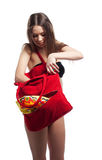 Woman search towel in red beach bag isolated Stock Photos