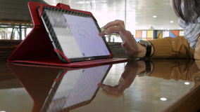 Woman Searching Address Using Touchpad With A Map. In Cafe stock footage