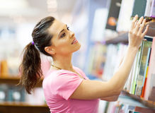 Woman searching book Stock Images