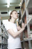 Woman Searching Books In Library Royalty Free Stock Images