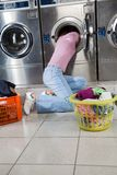 Woman Searching Clothes In Washing Machine Drum stock photography