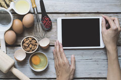 Woman searching the cooking menu and preparing food ingredient Royalty Free Stock Photos