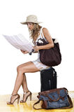 Woman searching for destination. Traveler woman searching for her destination on the map Royalty Free Stock Photography
