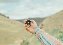 Free Woman Searching Direction With A Compass In Mountains, Pov. Stock Image - 185814181