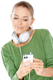 Woman searching her downloaded audio files Stock Photos