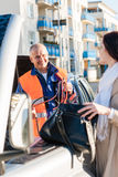 Woman searching her purse mechanic fixing car royalty free stock photos