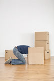 Woman Searching for Lost Item in a Moving Box Royalty Free Stock Photography