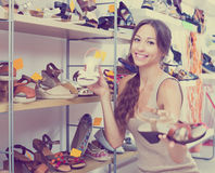 Woman searching new shoes Royalty Free Stock Image