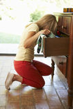 Woman Searching For Something In Drawers Royalty Free Stock Photography