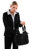 Woman searching for something. In her bag Royalty Free Stock Images
