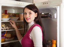 Woman searching for something in refrigerator. Brunette woman searching for something in refrigerator Stock Images