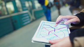 Woman searching station on underground map using stock video