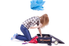Woman searching in a travel bag royalty free stock photo