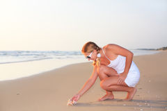 Woman with seashell Royalty Free Stock Photos