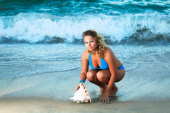 Woman with seashell Royalty Free Stock Photography