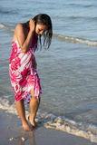 Woman on seashore Royalty Free Stock Image