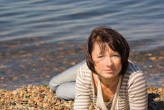 Woman at the seaside Royalty Free Stock Photography