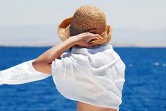 Woman on seaside Stock Image