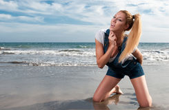 Woman at the seaside laughing Stock Photo
