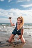 Woman at the seaside laughing Stock Image