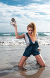 Woman at the seaside laughing Royalty Free Stock Image