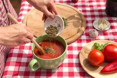 Woman is season a sauce Stock Photos