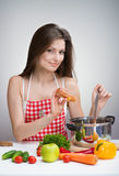 Woman seasoning soup Stock Images