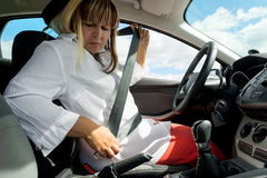 Woman with a seat belt in the car stock image