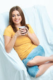 Woman seat in chair with cup Stock Photography