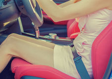 Woman with seatbelt on inside car. Driving safety concept Royalty Free Stock Photo