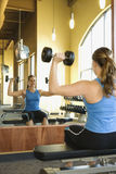 Woman Seated Lifting Weights Royalty Free Stock Photo
