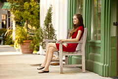 Woman seated outside Royalty Free Stock Images