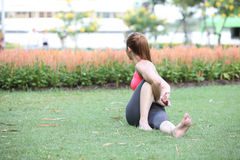 Woman in Seated Twist Yoga Pose on lawn. Photo of  Woman in Seated Twist Yoga Pose on lawn Royalty Free Stock Photos