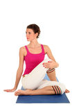Woman Seated in Yoga Pose. Turned to the Side Stock Images