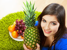 Woman seating on floor with fruits. Royalty Free Stock Photo