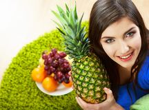 Woman seating on floor with fruits. Stock Images