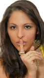 Woman secret. Beautiful young woman making the silence sign, keep the secret royalty free stock images