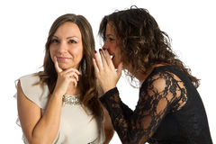 Woman secret. Two  girls sharing a secret or gossip Royalty Free Stock Images