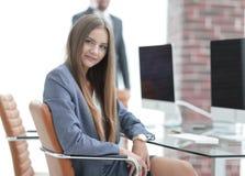 Woman secretary in a modern office Stock Photos