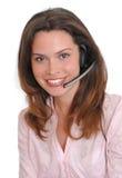 Woman secretary operator. Woman secretary with hands free set answering a call royalty free stock photo