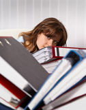 Woman secretary are overworked. Woman secretary in the office are overworked Stock Images