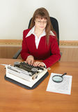 Woman secretary printing text on typewriter Stock Photo