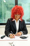 Woman secretary with red hair Royalty Free Stock Photo