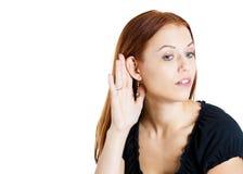 Woman secretly listening Royalty Free Stock Photography