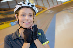 Woman securing strap riding helmet Stock Image